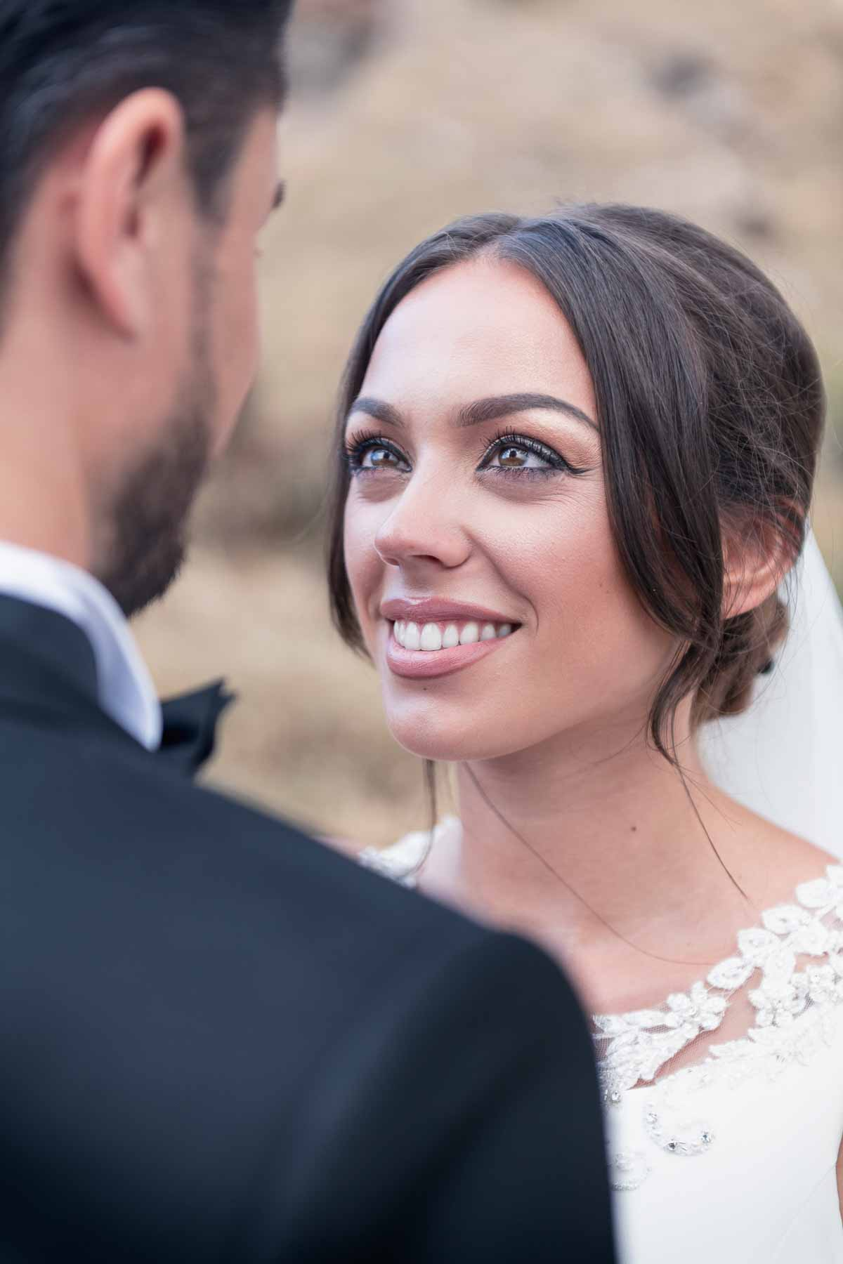 Bride is smiling at the groom