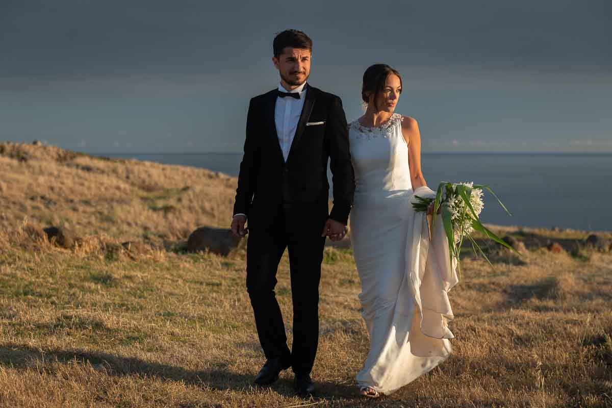 bride and groom at sunset in Madeira