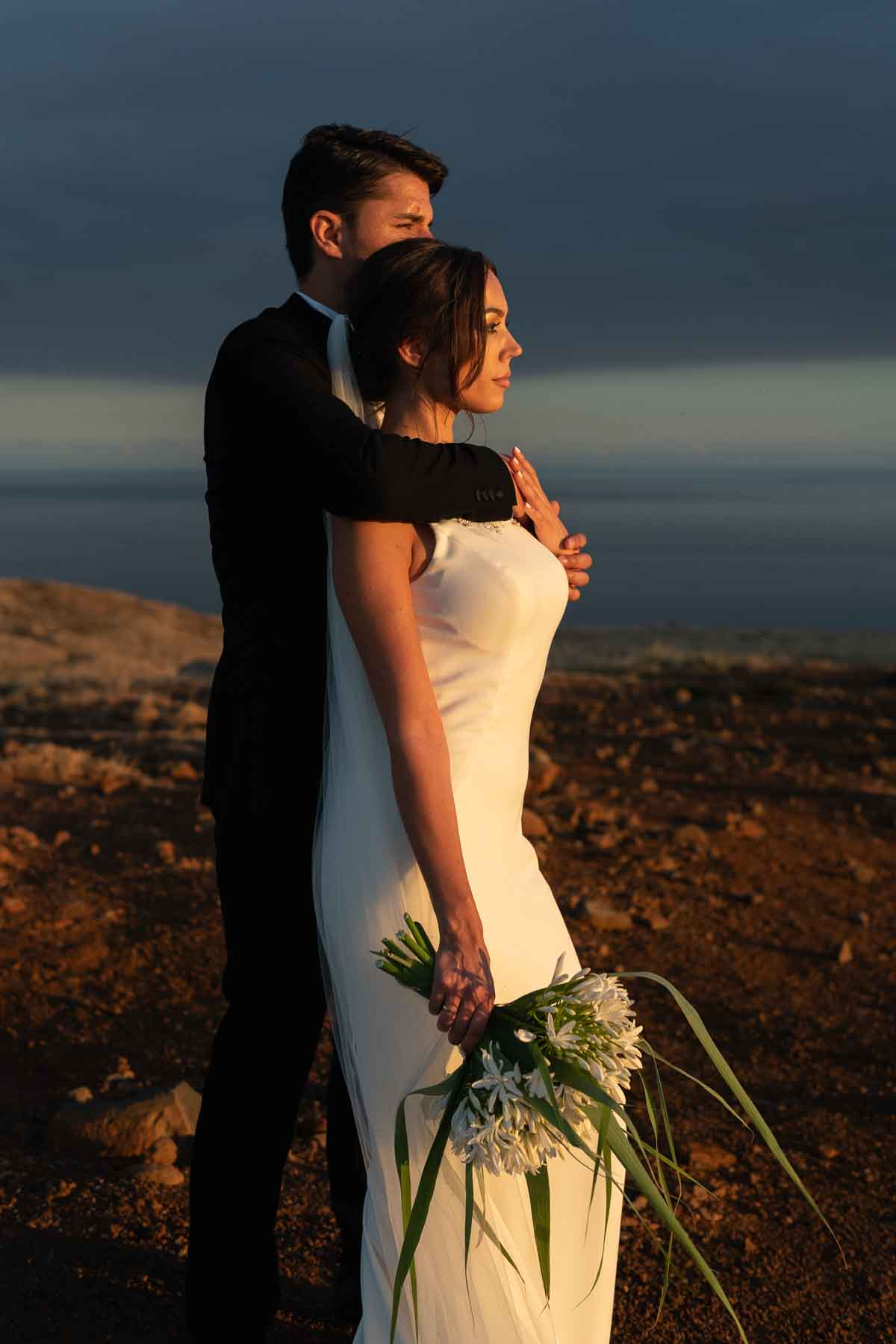bride and groom in Madeira during the sunset at Ponta do Sao Lourenco