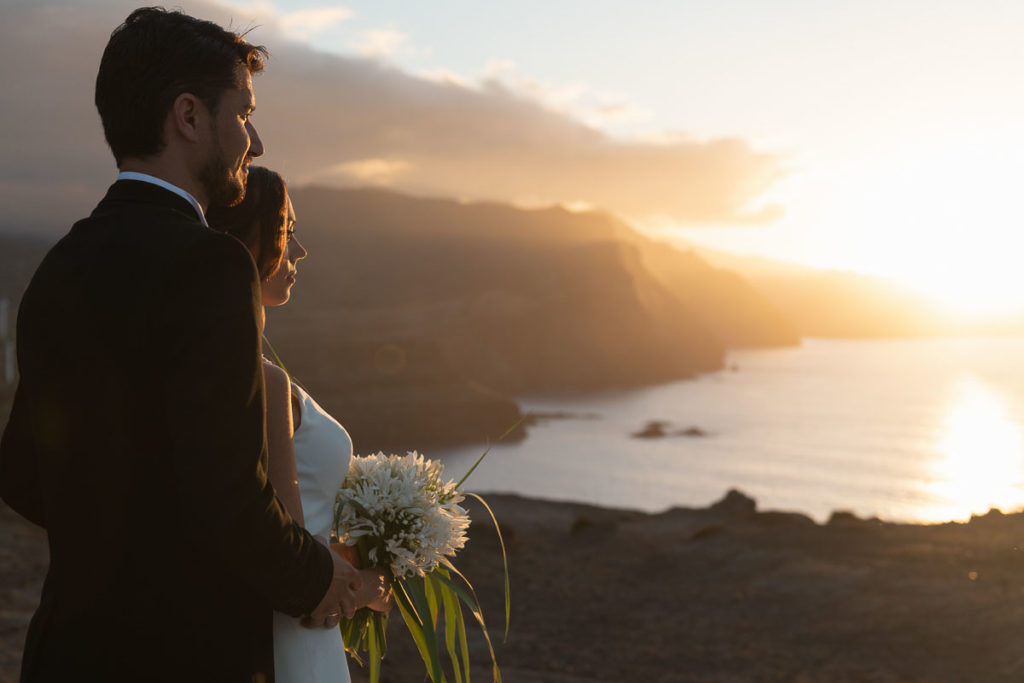 sunset and just-married couple