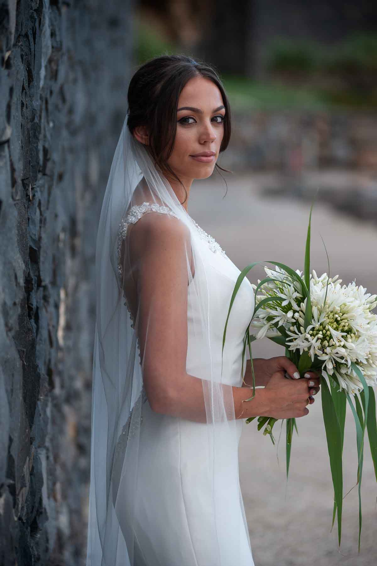 Bride with bouquet profile smiling