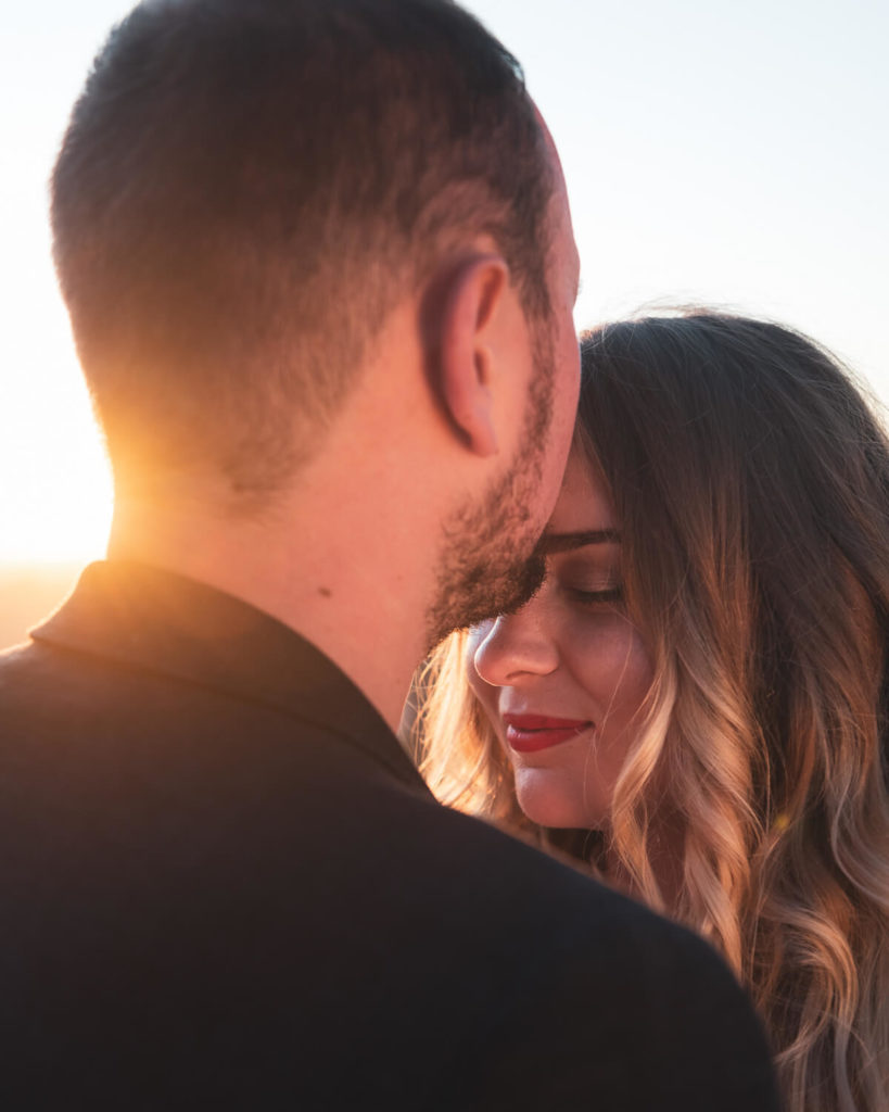 portrait of couple of newlyweds at sunset